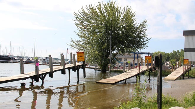 Docks at the DNR's Lake Macatawa Boating Access site are pulled up out of the water on Thursday, July 23, 2020. The boat launch closed until further notice on Thursday due to unsafe conditions created by the high lake levels.