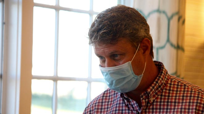 U.S. Rep. Bill Huizenga, R-Zeeland, listens to a constituent during a campaign event with the Michigan Republican Party at Anna's House restaurant in Holland, Mich. on Wednesday, Aug. 12.