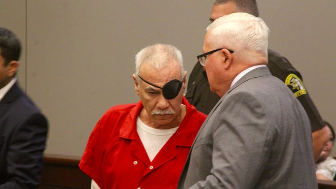 Salvador Ruiz speaks with his public defender Philip Sielski before the start of his preliminary exam in Holland District Court on Sept. 26, 2019.