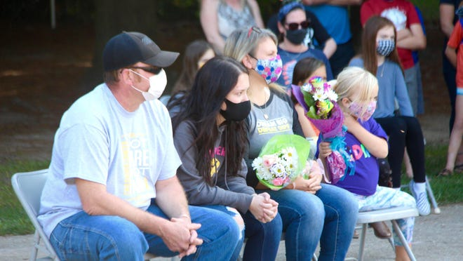 Mike, Taylor, Melissa and Ember Betts listen during a dedication cermony in honor of Avery Betts Friday night.