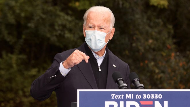 Former Vice President Joe Biden speaks at a  union facility in Grand Rapids, Mich. on Friday, Oct. 2, 2020. Biden, the Democratic candidate for president, stressed the importance of wearing a mask in his remarks, made the same day President Donald Trump tested positive for COVID-19.