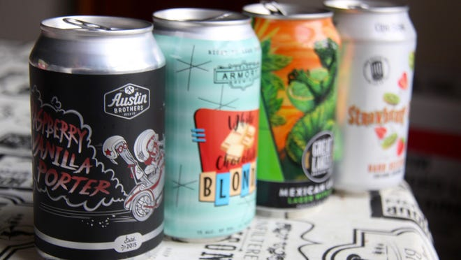 A series of cans from breweries in Michigan. Under a package of bills advancing in the Michigan House of Representatives, a series of reforms to the way the state captures bottle and can deposit funds and how the funds are used would take place.