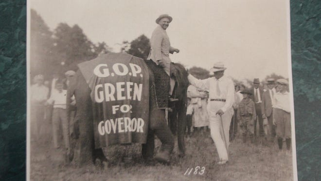"""This week's photo features Ionia Mayor and businessman Fred Green seated atop an elephant covered with a blanket stating """"G.O.P. GREEN FOR GOVERNOR."""" The picture was taken in 1926 at the fair grounds of the Ionia Free Fair which Green established in 1915."""