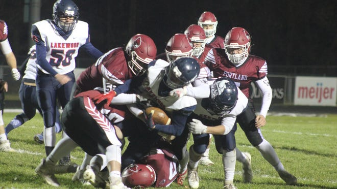 The Portland defense tackles the Lakewood ball carrier during a varsity football game Friday, Oct. 30, at Portland High School. Portland won 51-7.