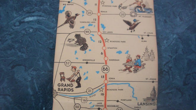 """This just in - Ruth French of Ionia who along with her husband owned and operated """"French's"""" store on Main Street, Ionia, for many years, has donated a map showing the shortest and best route to upper Michigan through scenic Michigan traveling on Highway 66. The map unfolds to take the traveler on the route of M-66 from Battle Creek to Charlevoix and offers a guide to seventeen towns along the way. IONIA is described as: """"Home of the famous Free Fair -- largest of its kind in the world. Michigan State Reformatory, also the State Mental Hospital located here. Brock County Park, 160 acres of natural beauty, baseball field, lodge, tennis courts, outdoor stoves, picnic facilities, deer. Surrounded by many fine fishing lakes. Ionia Manufacturing Co., largest maker of station wagon bodies in the world. Air port--121 acres CAA Class 1 airport."""" This delightful map was issued compliments of the Highway M-66 Association located at 120 Depot St., Ionia, Mich. The Sentinel office is currently at 114 Depot St. In 1891 the Ionia Daily Standard and Standard Publishing Co. were located at 120 N. Second St., which is now called Depot St. The Ionia County Historical Society is grateful to Ruth for sharing this piece of local history."""