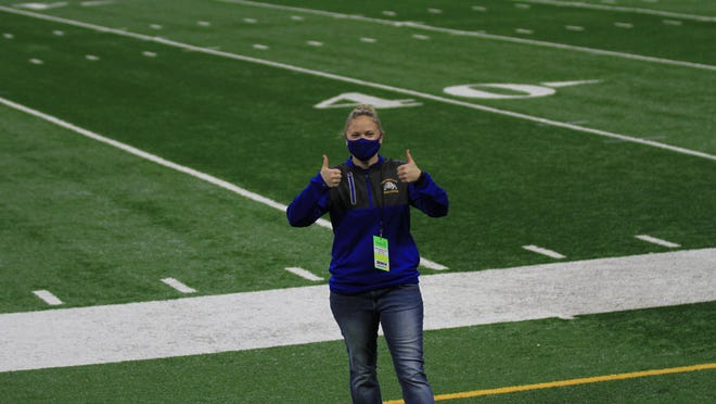 Centreville Athletic Director Jill Peterson was all smiles before Friday's game.