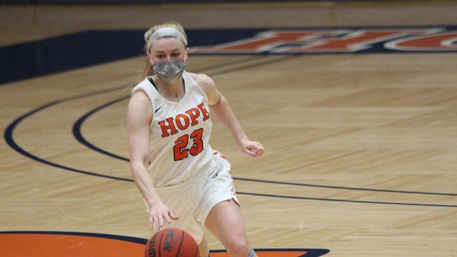 Hope College's Lauren Newman dribbles the ball upcourt during the Flying Dutch's win over No. 5 Trine on Wednesday, Feb 3, 2021 in Holland
