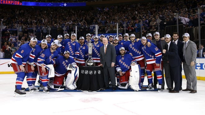 The Rangers pose with Deputy Commissioner Bill Daly and the Prince of Wales Trophy after defeating the Montreal Canadiens.