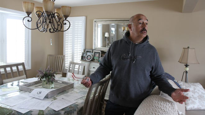 Sam Iacabone of Ortley Beach talks about the cracks in his walls that he believes were caused by the workers slamming steel plates into the ground as part of the Route 35 reconstruction.