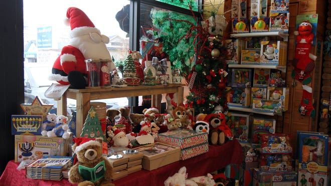 A holiday gift display is located by the front door of Kidegories, a kids' boutique in Shrewsbury.