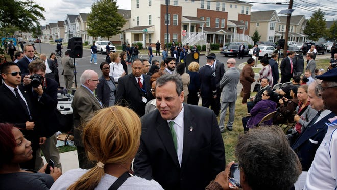 Gov. Chris Christie greets residents at a gathering in Elijah Perry Park in Camden on Sept. 24, 2014, to celebrate improvements in crime, education and economic development. Christie has made frequent stops in the high-crime city, stressing his efforts working with local Democratic lawmakers, including Mayor Dana Redd.
