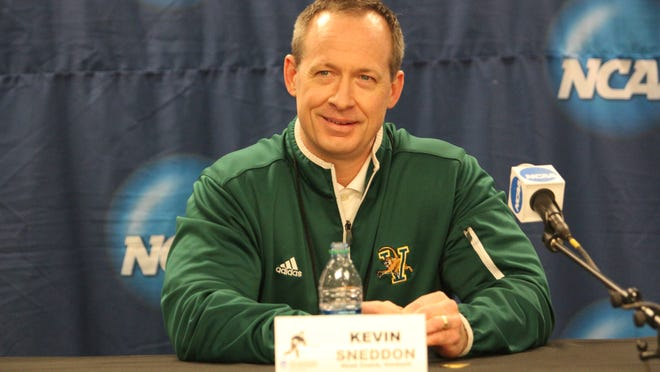 University of Vermont coach Kevin Sneddon addresses the media during the NCAA tournament in 2014.