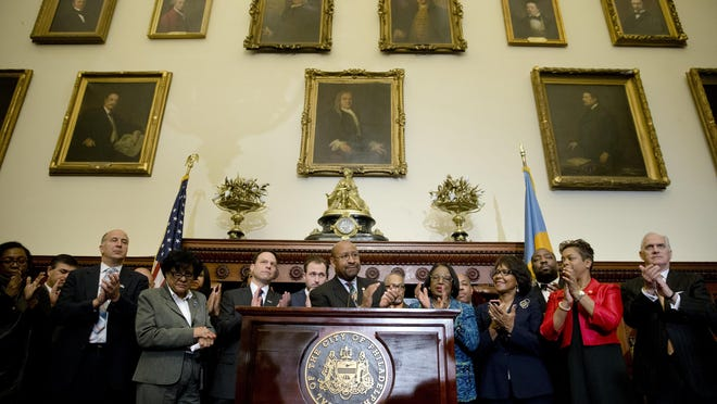 Philadelphia Mayor Michael Nutter, center, and others applaud during a news conference, Thursday, Feb. 12, 2015, at City Hall in Philadelphia. Democrats have selected Philadelphia as the site of the party's 2016 national convention, choosing a patriotic backdrop for the nomination of its next presidential candidate. The convention will be held the week of July 25, 2016 (AP Photo/Matt Rourke)