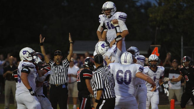 Elder quarterback Peyton Ramsey is hoisted by his teamates after rushing for a touchdown in the first half against Oak Hills.