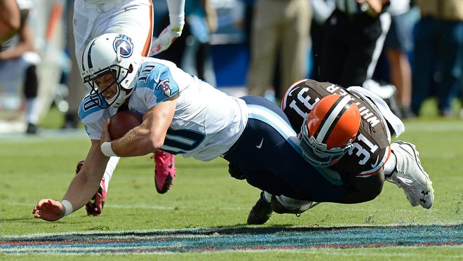 Tennessee Titans quarterback Jake Locker (10) is brought down by Cleveland Browns strong safety Donte Whitner (31) in the second quarter of an NFL football game Sunday, Oct. 5, 2014, in Nashville, Tenn. (AP Photo/Mark Zaleski)