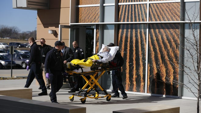 Governor Branstad is taken from a speaking event at Pioneer by ambulance Monday, Jan. 26, 2015.