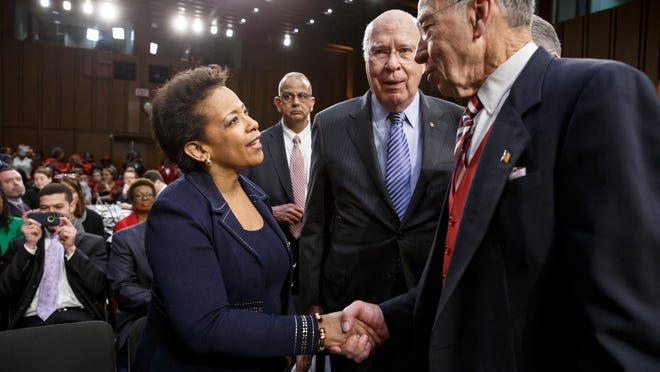Attorney general nominee Loretta Lynch, left, President Barack Obama's choice to run the Justice Department, is welcomed to her confirmation hearing by Senate Judiciary Committee Chairman Chuck Grassley, R-Iowa, right, and Sen. Patrick Leahy, D-Vt., the ranking member, center, on Capitol Hill in Washington, Wednesday, Jan. 28, 2015. This is the first nomination hearing under the new Republican majority.