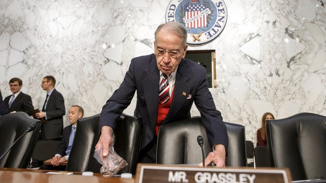 Senate Judiciary Committee Chairman Sen. Chuck Grassley, R-Iowa, is the first to arrive on Capitol Hill in Washington, Wednesday, Jan. 28, 2015, for the confirmation hearing on President Barack Obama's nomination of Loretta Lynch to be attorney general. Grassley, who heads the Senate panel that will decide Lynch's confirmation, is an 81-year-old farmer who never got a law degree.