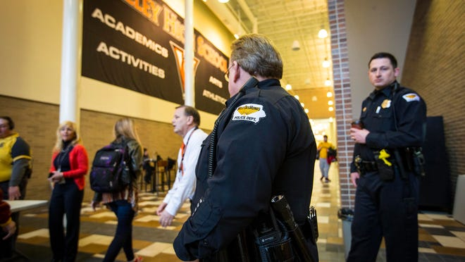 West Des Moines Valley High School had an increased police presence Monday, with school officials also performing random bag checks on students arriving for school.