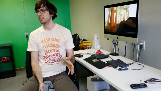 """Josh Larson, developer of the video game """"That Dragon, Cancer,"""" talks about how he and his business partner came to Kickstarter to help fund their work Wednesday, March 18, 2015, at his office in Des Moines."""