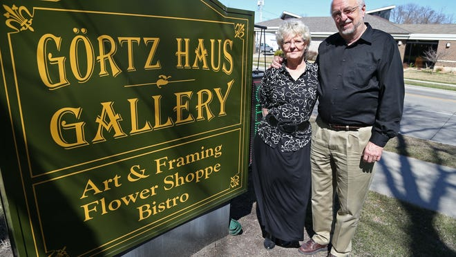 Dick and Betty Odgaard, owners of the Gortz Haus Gallery in Grimes, stand outside their store on Tuesday, March 31, 2015.