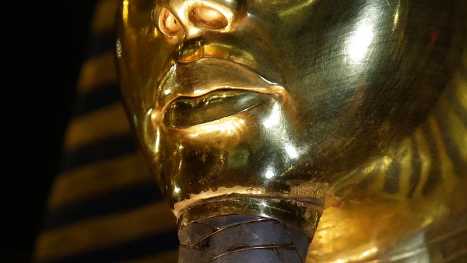 A detail of the gold mask of King Tutankhamun showing where the beard is attached is seen Saturday, Jan. 24, 2015, in a glass case during a press tour in Cairo, in the Egyptian Museum near Tahrir Square, Cairo, Egypt. German restoration specialist, Christian Eckmann, summoned to Cairo to examine the damaged burial mask.