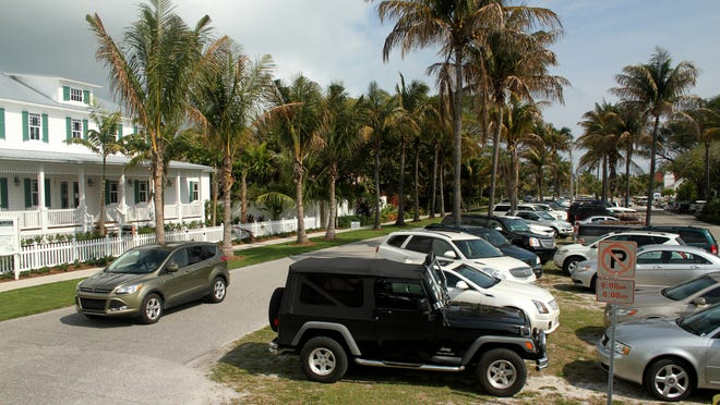 The median of 3rd St. and Gilchrist Av. in Boca Grande sits filled with vehicles that utilize the space for parking outside of three churches that line the street. Neighbors that live on Gilchrist Av. feel that no one should park on the medians and should use the empty lots across the street.