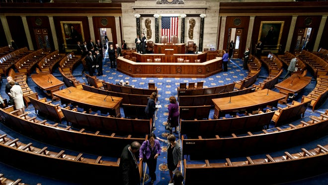 The chamber of the House of Representatives empties following a joint meeting of Congress, at the Capitol in Washington, Thursday, Sept. 18, 2014, with visiting Ukranian President Petro Poroshenko. The House and Senate are wrapping up business and heading to their home states for the weeks leading up to the midterm elections. (AP Photo/J. Scott Applewhite)