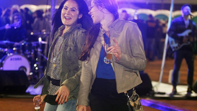 Katie Gold, left, and Samantha Fortune enjoy a dance as they drink beer and listen to the live music of the band Soapy Tuna during Saturday's Ballpark Festival of Beers.