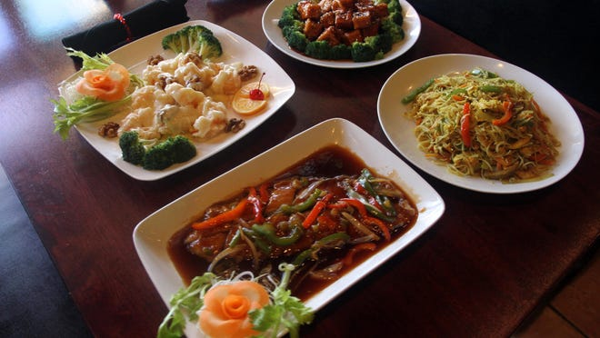 Some of the meals on the Chinese New Year menu prepared by Chen's China Bistro in Cape Coral are pictured clockwise from top left: Honey Walnut Shrimp, Golden Sesame Chicken, Singapore Mai Fun, and Chen's House Fish.