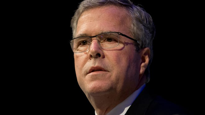 """Former Florida Gov. Jeb Bush speaks at a Economic Club of Detroit meeting in Detroit Wednesday, Feb. 4, 2015. The Detroit event is the first in a series of stops that Bush's team is calling his """"Right to Rise"""" tour. That's also the name of the political action committee he formed in December 2014 to allow him to explore a presidential run. (AP Photo/Paul Sancya)"""