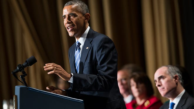 """President Barack Obama speaks during the National Prayer Breakfast in Washington, Thursday, Feb. 5. The president condemned those who seek to use religion as a rationale for carrying out violence around the world, declaring Thursday that """"no god condones terror."""" Sen. Bob Casey, D-Pa. is at right."""