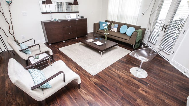 Jeanne Kiley's open living room at the Maxwell Apartments offers a view of the courtyard.