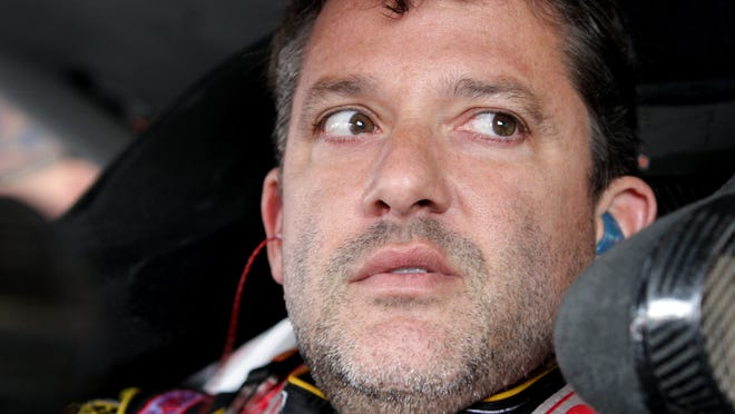 Tony Stewart, driver of the #14 Rush Truck Centers/Mobil 1 Chevrolet, sits in his car during practice for the NASCAR Sprint Cup Series Cheez-It 355 at Watkins Glen International on August 8, 2014 in Watkins Glen, New York.