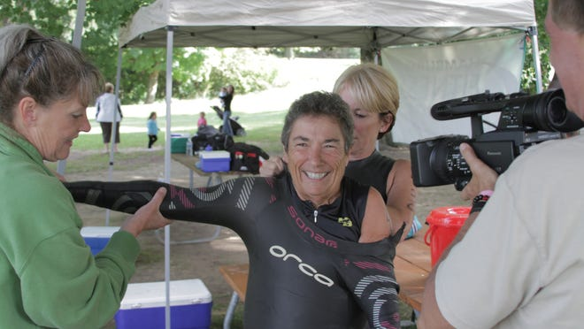 """Brenda Badish, 73, dons a wet suit while being filmed for a segment in the 13-part documentary series, """"The Embrace of Aging: The Female Perspective of Growing Old."""" Badish once was confined to a wheelchair due to her weight. She has since lost more than 170 pounds."""