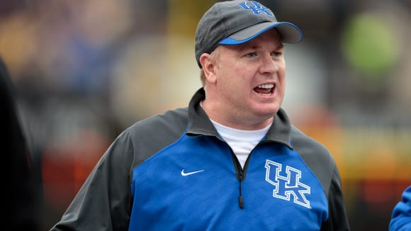 FILE - In this Nov. 16, 2013, file photo, Kentucky head coach Mark Stoops watches from the sideline during the second quarter of an NCAA college football game against Vanderbilt in Nashville, Tenn. Kentucky has extended the contract Stoops through the 2018 season, the university said in a statement Tuesday, May 6, 2014. (AP Photo/Mark Humphrey, File)