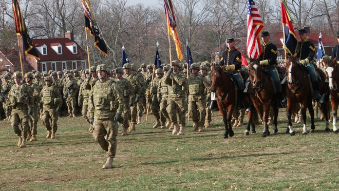 Soldiers from Duke Brigade at Ft. Knox pass in review in a deployment ceremony in 2010. The unit was recently deactivated at Fort Knox, which officials say could face further cuts. (By Michael Hayman, The Courier-Journal)