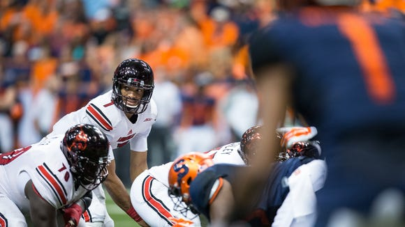 U of L quarterback Reggie Bonnafon lines up under center against the Syracuse Orange last Friday at The Carrier Dome in Syracuse, New York.