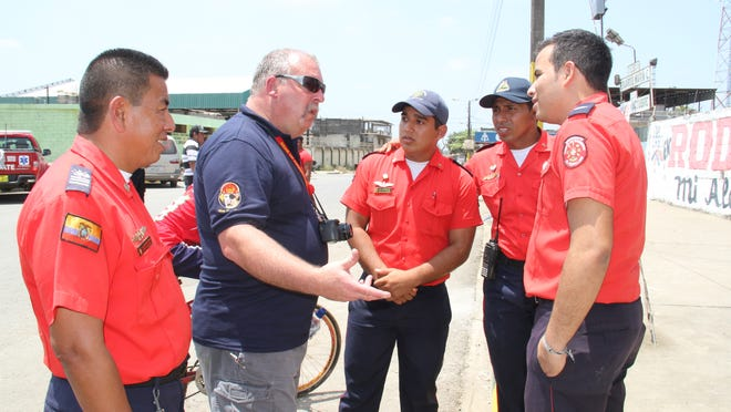 Pittsville Fire Chief Jerry Minor speaks to a group of firemen in Guayaquil, Ecuador while on a training session to that country.