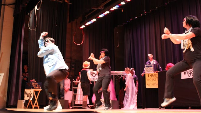 """Erik Stratman, left, performs """"Gangnam Style"""" by Psy during Columbus Catholic Schools' Alpine Holiday Saturday afternoon."""