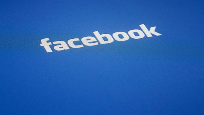 A Facebook logo is displayed on the screen of an iPad, in this Wednesday, May 16, 2012, file photo taken in New York.