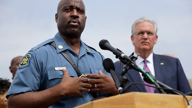 Capt. Ron Johnson of the Missouri Highway Patrol, left, the new commander in Ferguson promises to be more transparent in the investigation of the death Aug. 9 of Michael Brown.