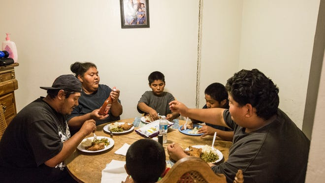 Clarence Cruz, Marissa Holmes and their kids are thankful to have their own apartment after living in a homeless shelter for a year and a half.