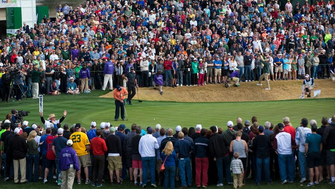 The 2014 Waste Management Phoenix Open, with winner Kevin Stadler putting on the 18th green, set an overall attendance record with 563,008 spectators.