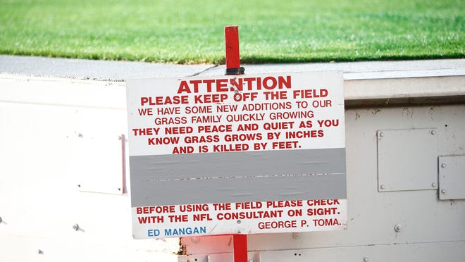 Keep off the field sign post on the Pro Bowl field at University of Phoenix Stadium on Tuesday, Jan. 20 2015 in Glendale, AZ.