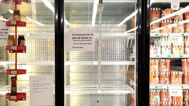 OVERLAND PARK, KS - APRIL 21: Shelves are bare and signs are posted where Blue Bell products were displayed in a grocery store on April 21, 2015 in Overland Park, Kansas. Blue Bell Creameries recalled all products following a Listeria contamination. (Photo by Jamie Squire/Getty Images) *** BESTPIX ***