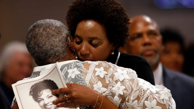 Hasna Muhammad, facing, embraces her sister Nora Davis Day during a memorial service for their mother, actress Ruby Dee, at The Riverside Church, Saturday, Sept. 20, 2014 in New York.