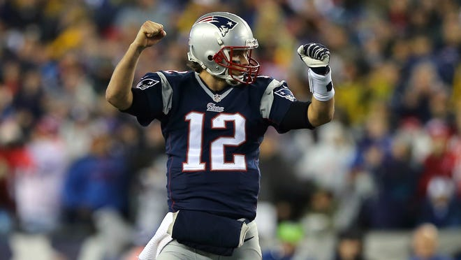 New England QB Tom Brady completed 23 of 35 passes Sunday for 226 yards and three touchdowns.