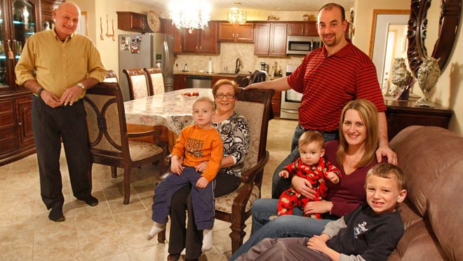 Peter and Debby Cirri pose with their children, Christopher, 4, Matthew, 9 months, and Frankie, 6, and Peter's mother, Lina Cirri, in their in-law suite they added on to the family's Chili home for Lina, Monday, Jan. 12, 2015. Thomas Doughty, architect, P.C., left, designed and planned the suite.