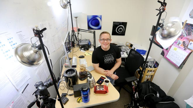 Paul Solt is in his 80-square-foot office space where he developed an app for coffee brewing as well at creating instructional videos on the subject.